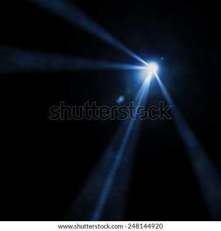 Light of a searchlight beams through a smoke. Background in show - stock photo
