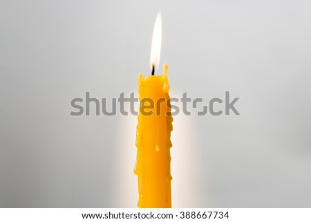 Light of candle put on gray background - stock photo