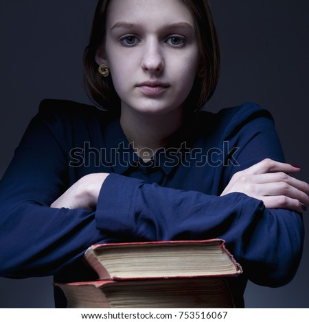 Light of knowledge. Young Student Girl with Books (Education and self development concept)