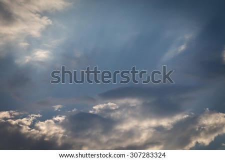light of sunbeam on blue sky background with clouds and sun light - stock photo