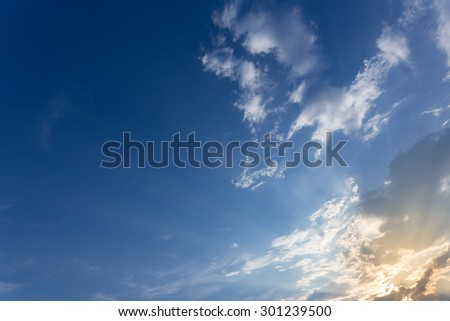 light of sunbeam on blue sky background with clouds and sunlight - stock photo
