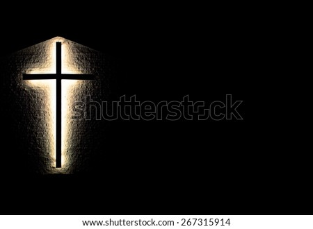 Light Of The World. Illuminated cross on a brick wall in horizontal orientation with copy space. - stock photo