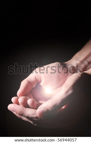 light on the hands - stock photo