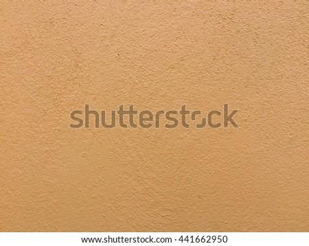 Light orange concrete wall texture background, yellow concrete texture - stock photo
