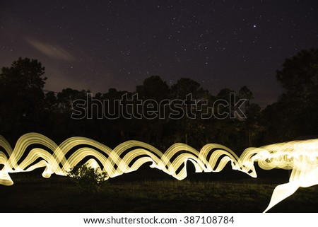 Light Painting with Star Filled Sky. Great for use as a background element.