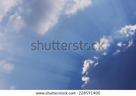 light pass through the cloud under the blue sky   - stock photo