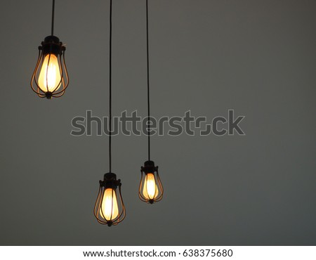 Light pendants with concrete wall background