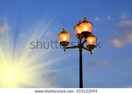 light pole in evening and sun beams - stock photo