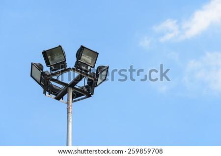 Light pole on blue sky background. - stock photo