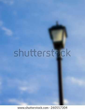Light pole with blue sky in Blur style - stock photo