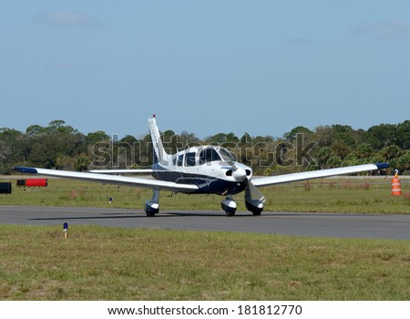 Light private airplane taxiing on the ground - stock photo