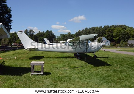 Light private airplanes parked in the countryside - stock photo