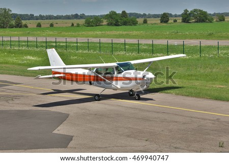 Light private plane on the airfield taxiing for a leisure flight in summer