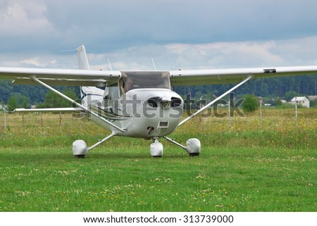 Light private plane taking off from on a stormy day - stock photo