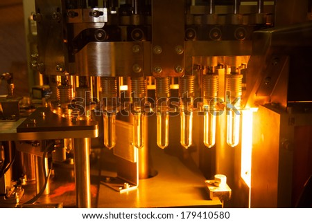 Light quality control of test tubes, vials - stock photo