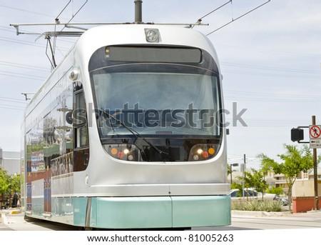 Light rail train of the Phoenix Metro system photographed in Tempe Arizona. - stock photo