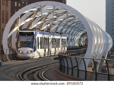 Light rail train traverses a flyover in The Hague City Center - stock photo
