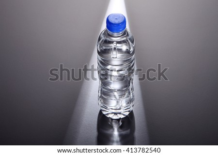 light ray shine on a bottle of mineral water - stock photo