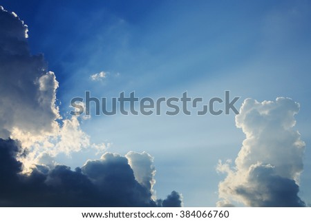 light rays on dramatic moody sky - stock photo