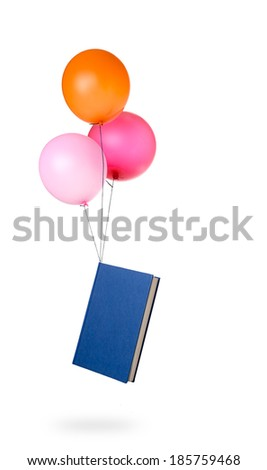 Light reading - book seemingly carried by balloons  - stock photo