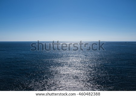 Light reflection on sea surface looking towards horizon / View of horizon at Atlantic ocean at Brittany, France