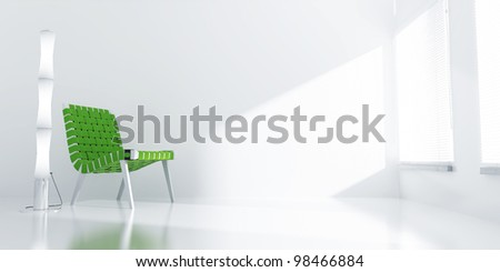 light room with a green chair and light from a window - stock photo