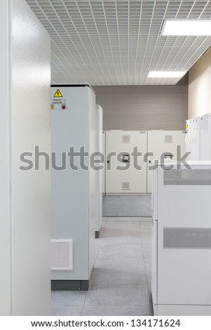 Light room with rows of racks with equipment for telecom. - stock photo