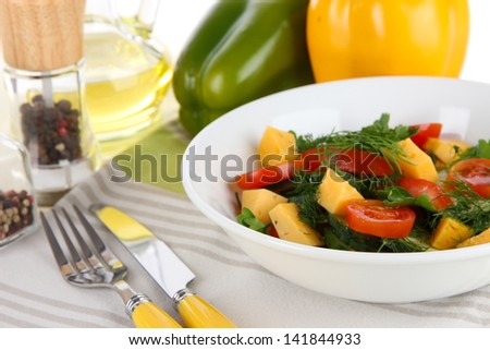 Light salad in plate on wooden table