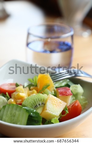 Light salad with fresh fruits on the table