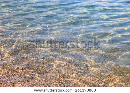 Light shapes under clear water of the Adriatic sea on Croatian coastline  - stock photo