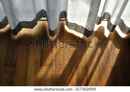 light shine through the curtain. Close up of draperies at a window. - stock photo