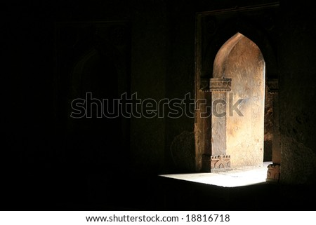 Light shining through a window of a tomb monument, delhi, india