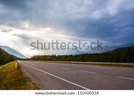 Light shining to the road after storm - stock photo