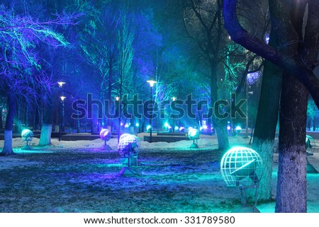 light show, a mysterious New Year lighting illumination. The lighting in the form of cosmic spheres. The photo was taken at slow shutter speeds. Snow, winter, Christmas. Close-up, copy space.Planets - stock photo