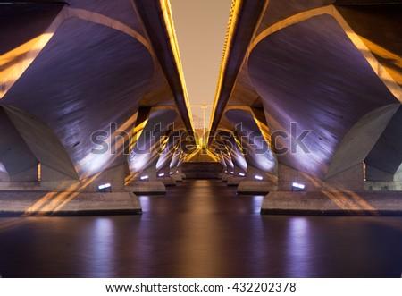 light show and shadow of under Esplanade Bridge, Singapore. - stock photo