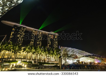 Light shows a panorama of Singapore, March 29, 2014 in Singapore. Night light show at Supertree Groveis is main Marina Bay Sands district tourist attraction