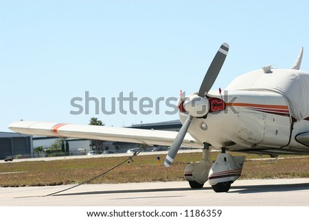 light single engine airplane parked