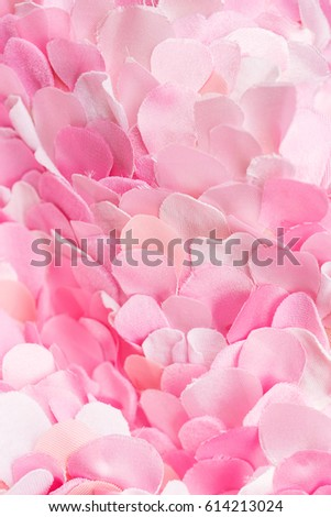 Light soft pink textile petals background. Flower blossom wallpaper, top view