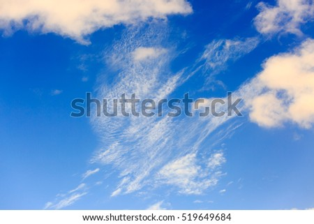 Light spindrift clouds on a blue sky