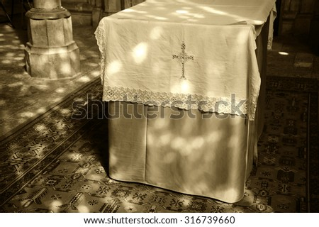 Light spots on the altar and the floor in church. Sunlight filtered through the stained glass window. A game of light and shadow. Aged photo. Sepia. - stock photo
