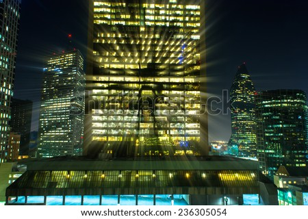 Light streaks coming out of a downtown building at night