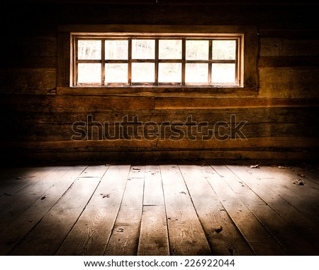 "Light streaming inside window of the Noah ""Bud"" Ogle Place cabin along the Roaring Fork Motor Nature Trail in Great Smoky Mountains National Park, Tennessee - stock photo"