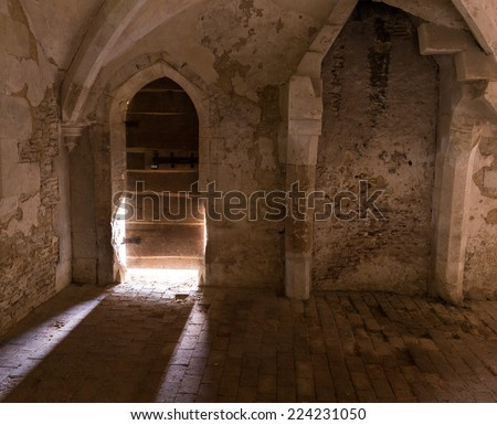 Light Streaming Through Old Abbey Wooden Door  - stock photo