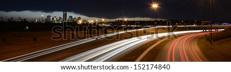 Light Streams and Calgary Skyline. Traffic on Deerfoot Trail - stock photo