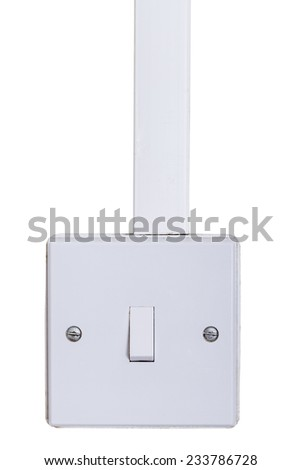 Light switch mounted on white wall with copy space. Old square box style switch on  white background. - stock photo