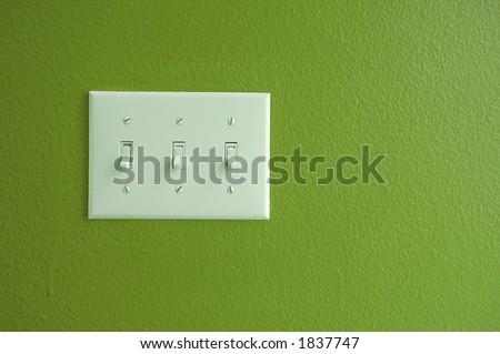 Light switch on green - stock photo