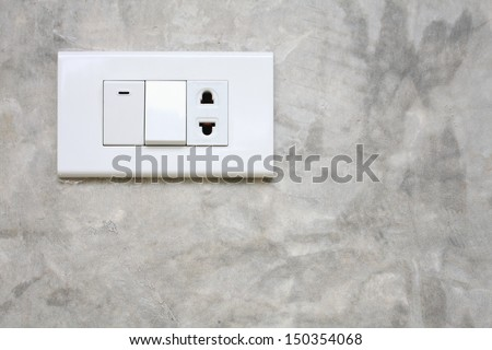 Light switch on the wall cement - stock photo