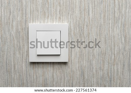 Light switch / White light switch on grey wall / Concept / On Off - stock photo