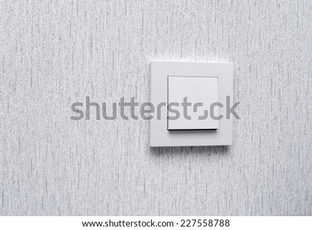 Light switch / White light switch on white wall / Concept / On Off - stock photo
