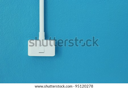 Light switches on the blue wall - stock photo